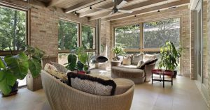 Luxery Sunroom with Wicker Furniture