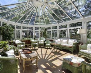 Solarium with Green Wicker Furniture