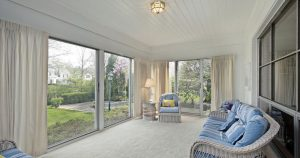 Sunroom with Wicker Sofa, Chair and Curtains for Window Treatments