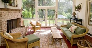 Sunroom with Wicker Furniture and a Fireplace