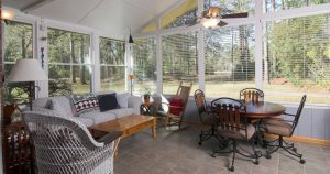 Furnishing a Sunroom with Wicker Furniture and Dining Set