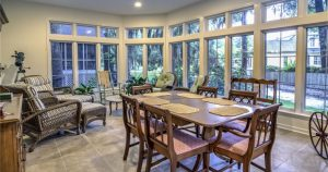 Sunroom with Dining Set and Wicker Furniture